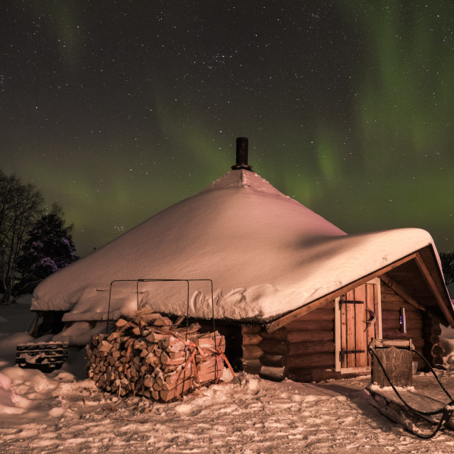 """Trekkers' shelter in Finnish Lapland with Northern Lights"" stock image"