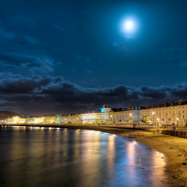 """Full moon over Llandudno promenade"" stock image"
