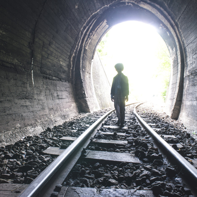 """Child walking in railway tunnel"" stock image"