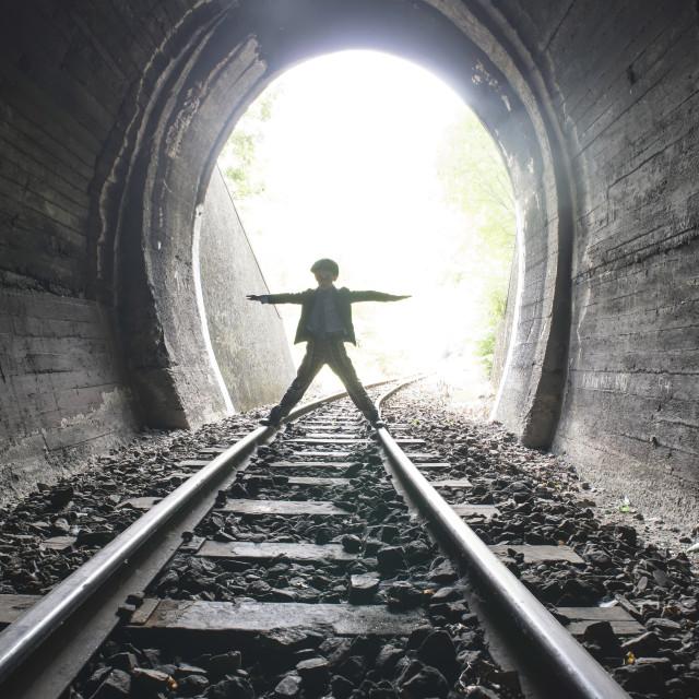 """Child walking in railway tunnel"" stock image"