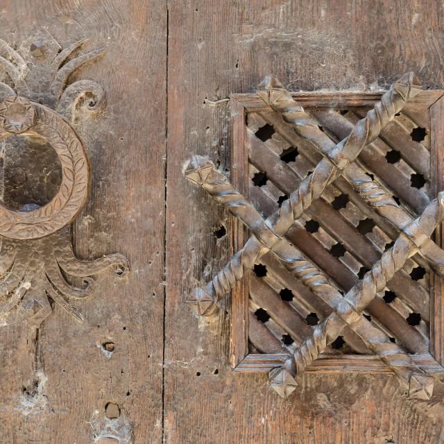 """Old window grille and door knocker"" stock image"