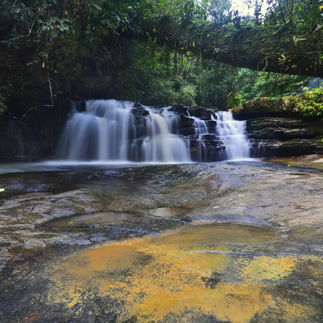 """Majestic waterfall in the dense rainforest of Jeram Pelangi"" stock image"