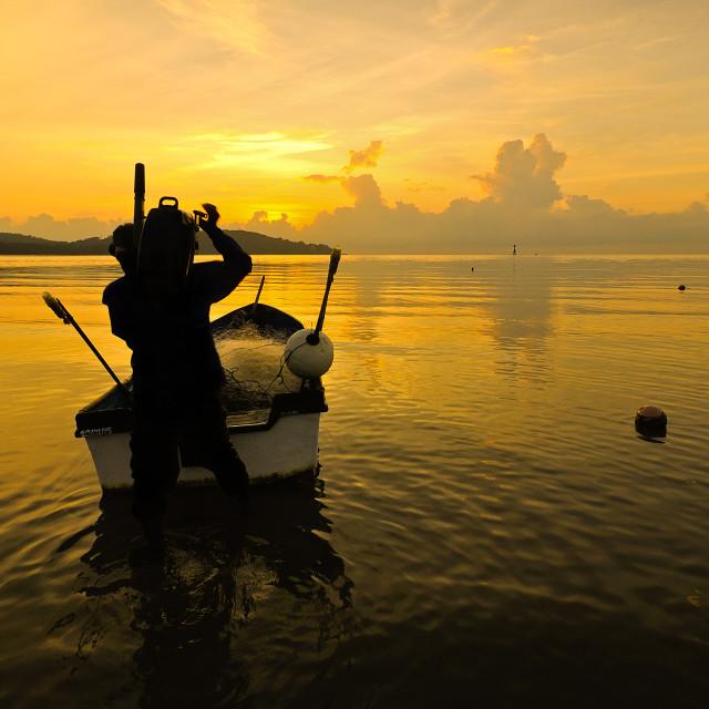 """Scenic view at Kuantan ocean at Malaysia with fishman in boat"" stock image"