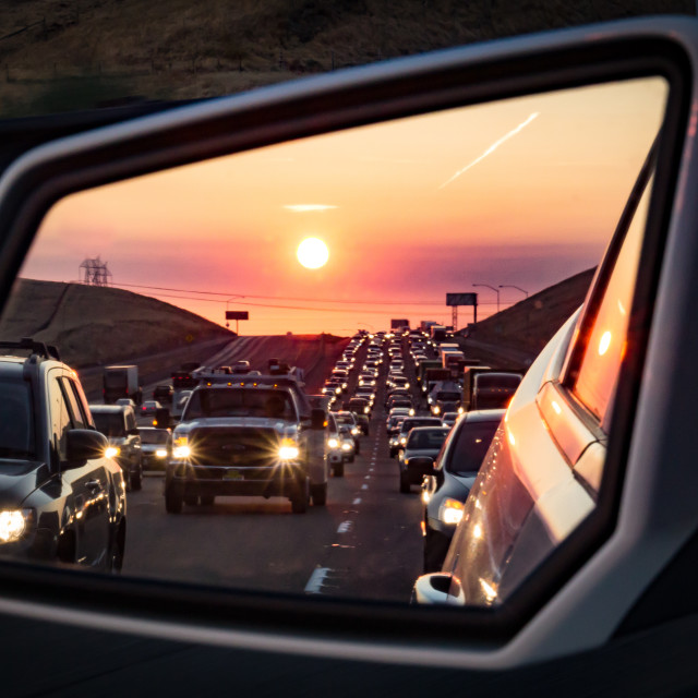 """Traffic in the rearview mirror at sunrise"" stock image"