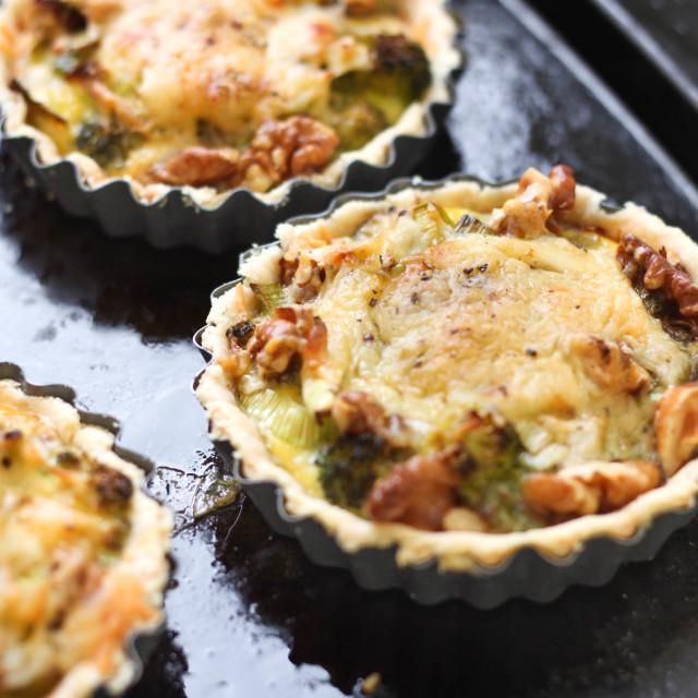 """""""Cheesy broccoli and walnut tart"""" stock image"""