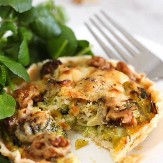 """Cheesy broccoli and walnut tart"" stock image"