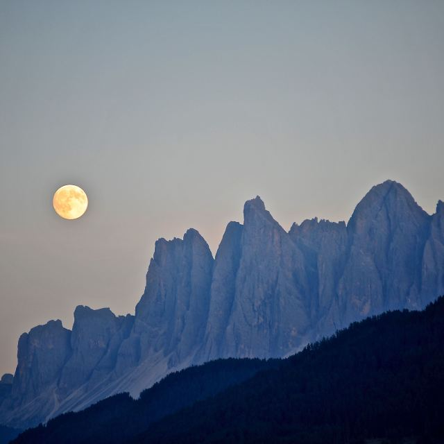 """The moon and the mountains"" stock image"