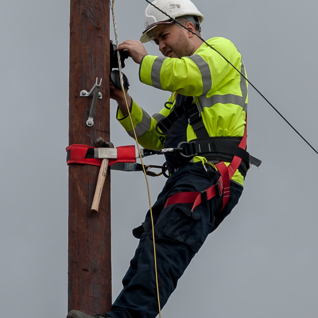 """Telecoms Engineer High Wire Act"" stock image"
