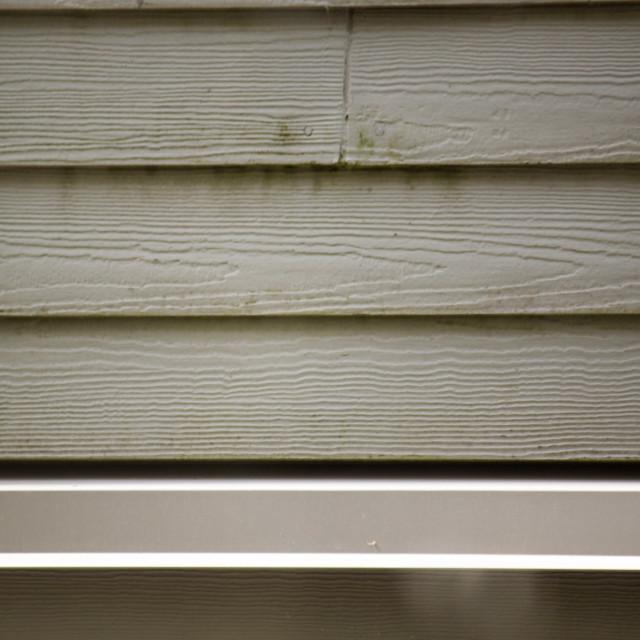 """aluminum gutter and white siding"" stock image"