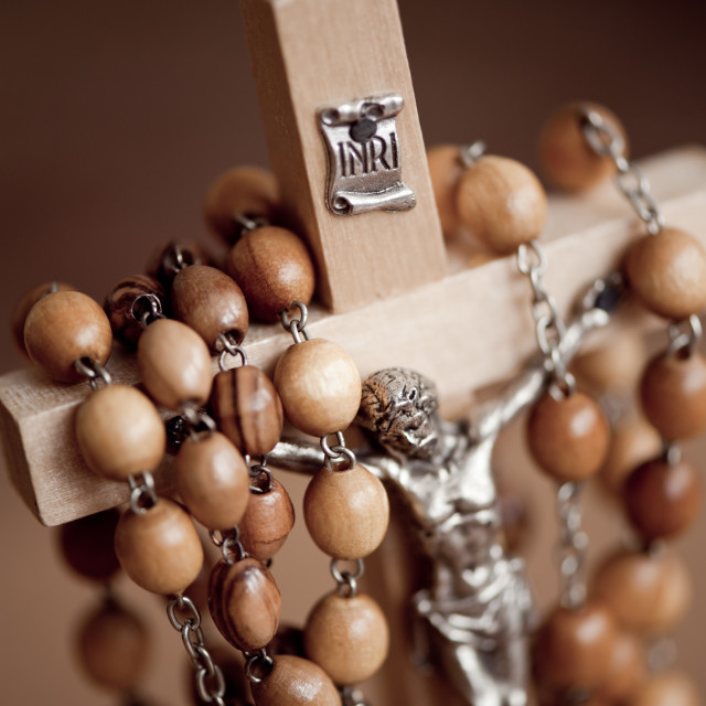 """Figurine of Jesus in wood rosary"" stock image"