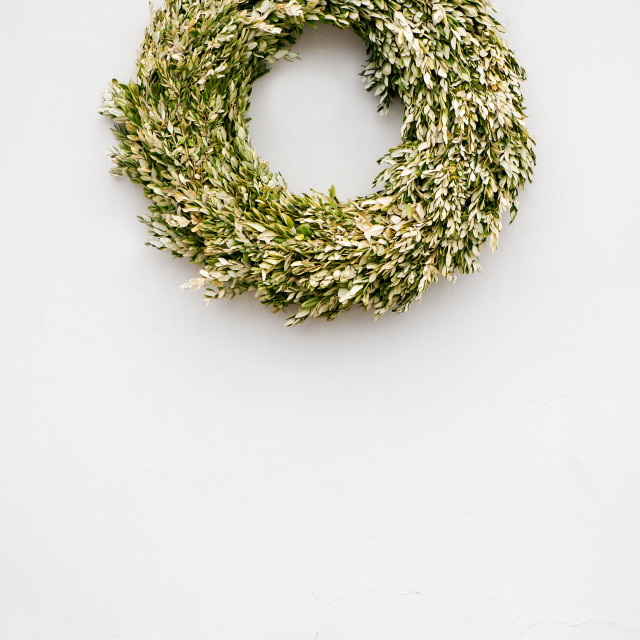 """Buxus wreath on white wall"" stock image"
