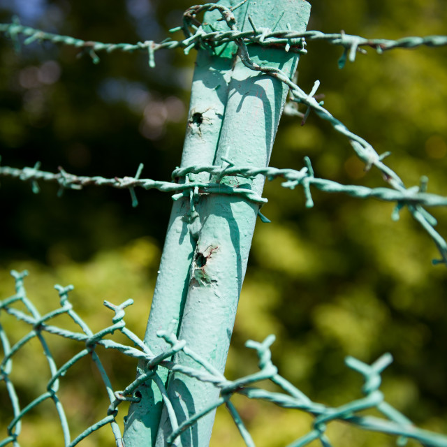 """""""old steel barbed wire fence"""" stock image"""