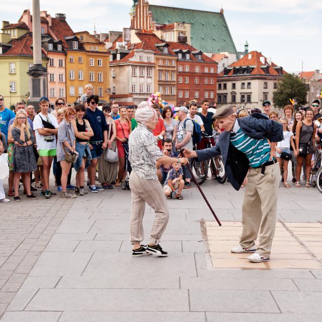 """Tourists watching street dance"" stock image"