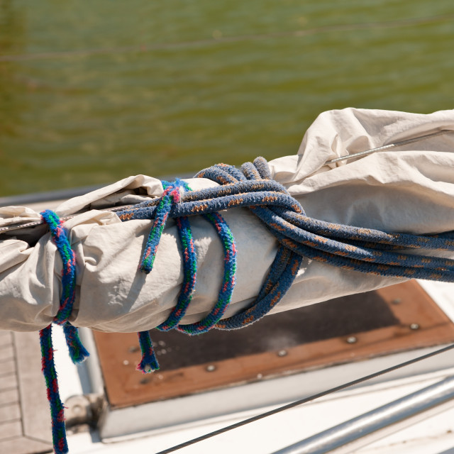 """""""Rolled up mast sail cloth"""" stock image"""