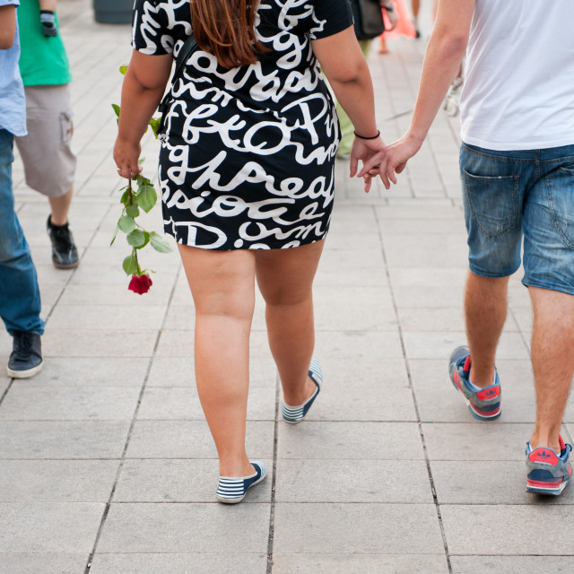 """Overweight girl with boyfriend"" stock image"