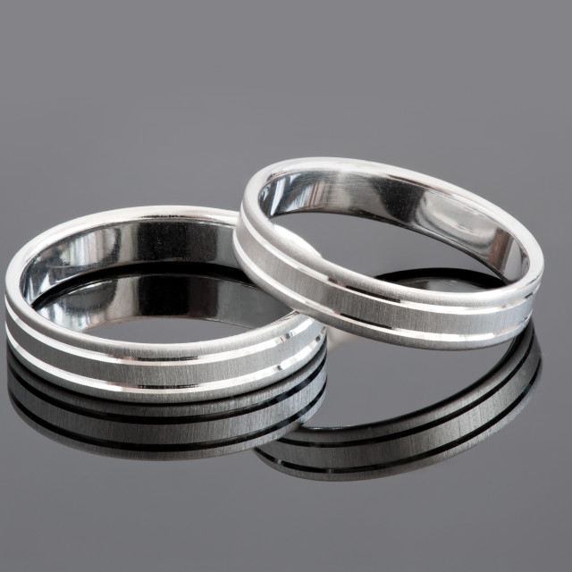 """Two silver wedding rings"" stock image"