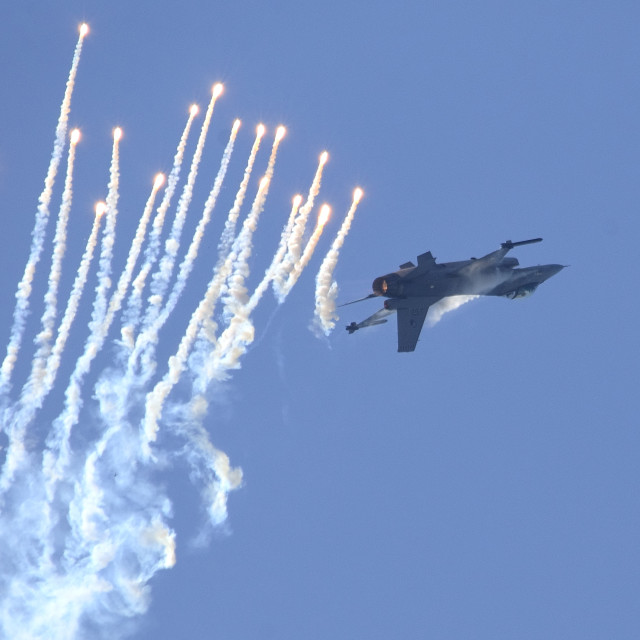 """F16 Fighter Falcon with decoy flares"" stock image"