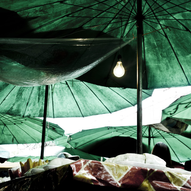 """Green Parasols at a Thai street food market"" stock image"