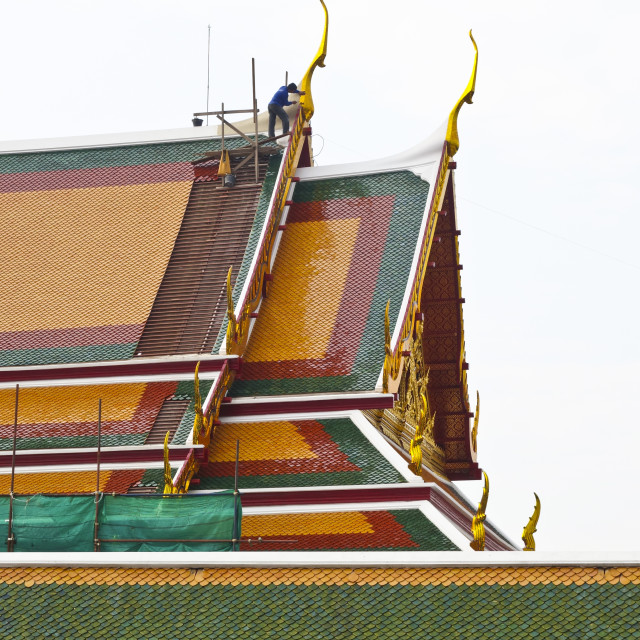 """""""Worker at Rooftops Wat Arun"""" stock image"""