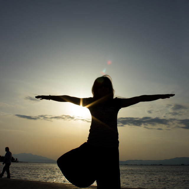 """Yoga at the beach 1"" stock image"