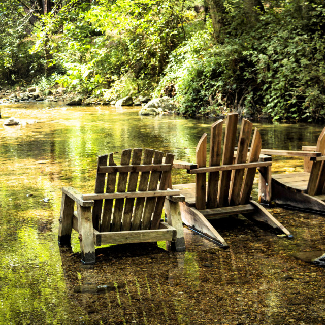 """""""Adirondack chairs ready for lounging in the river"""" stock image"""