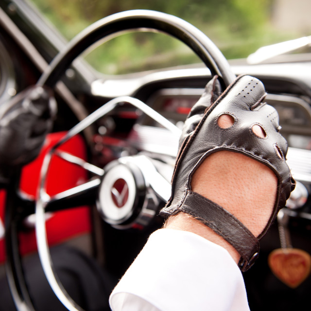 """Leather gloves on drivers hands"" stock image"