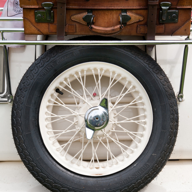 """""""Spare wheel tire and leather suitcase"""" stock image"""