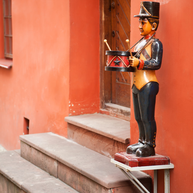 """Carved drummer effigy decoration"" stock image"