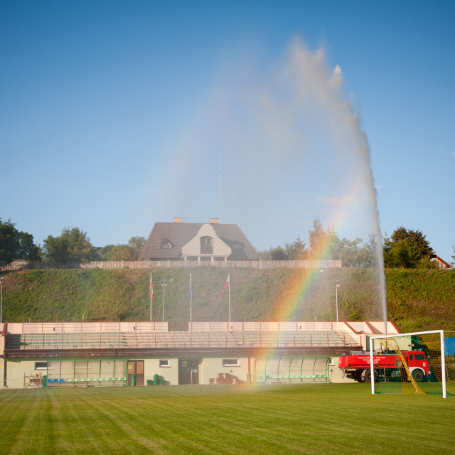"""""""Fire brigade watering playing field"""" stock image"""