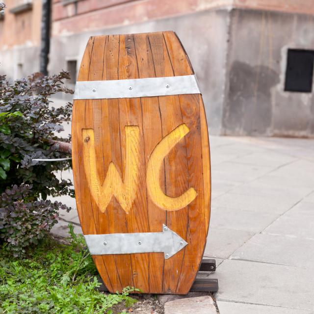 """Public wooden barrel shape toilet"" stock image"