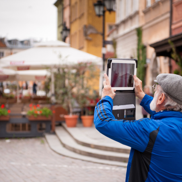"""Tourist taking photo with iPad"" stock image"