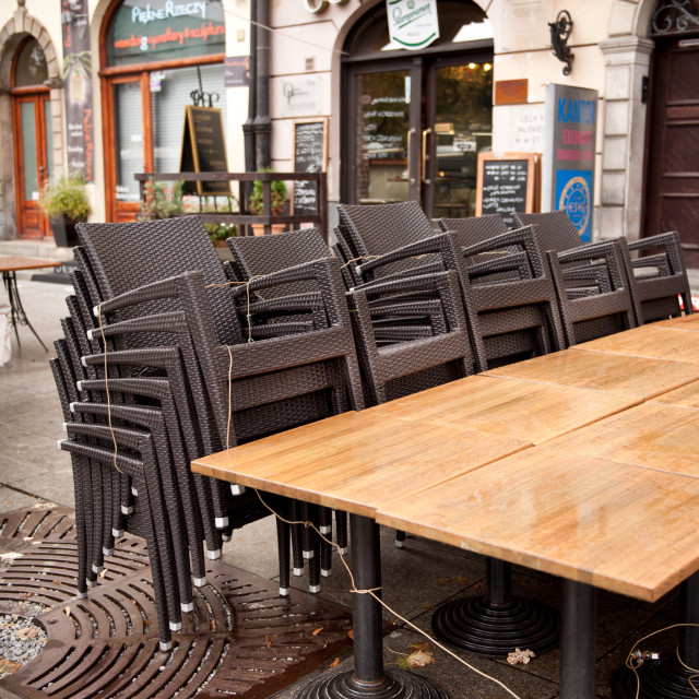 """""""Plastic chairs binded to tables"""" stock image"""
