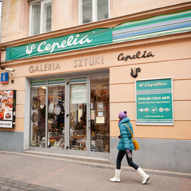 """Girl walking in front of Polish Cepelia"" stock image"