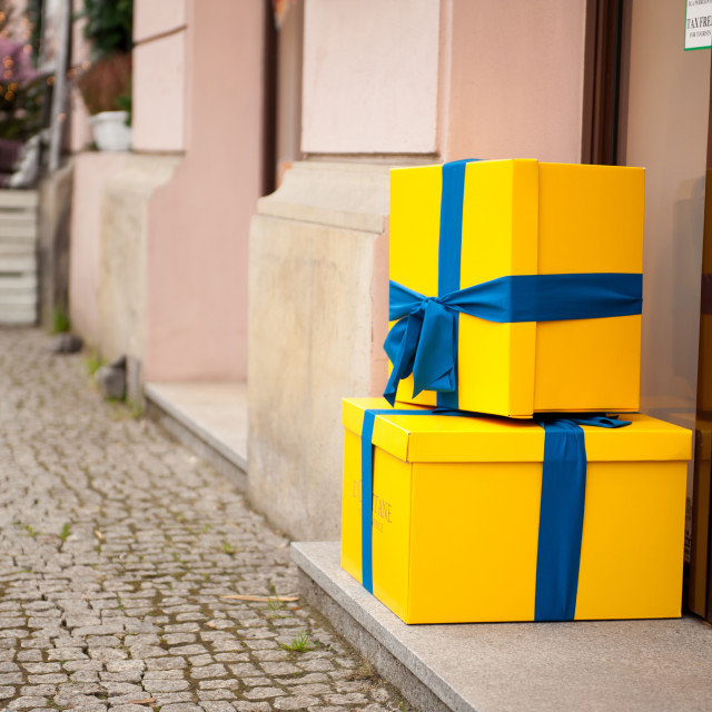 """Yellow Xmas gifts with blue ribbon"" stock image"