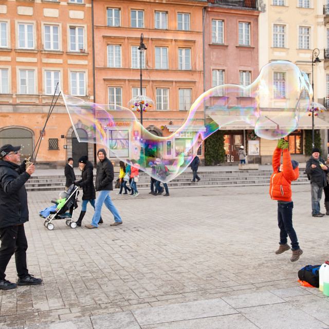 """Man making huge soap bubble"" stock image"