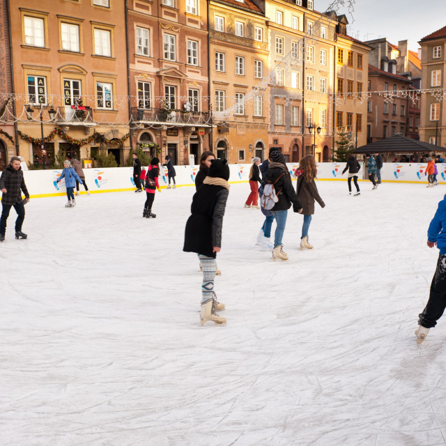 """People enjoy skating on ice rink"" stock image"