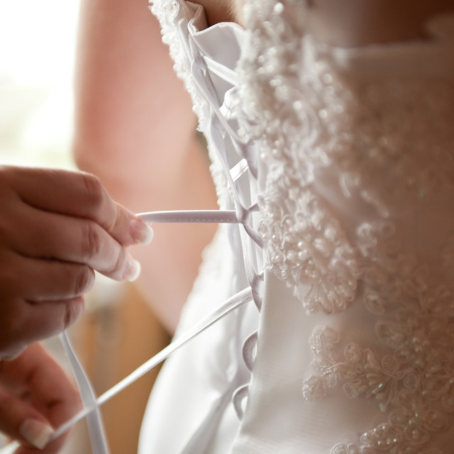 """Bridal prepare white dress bind"" stock image"