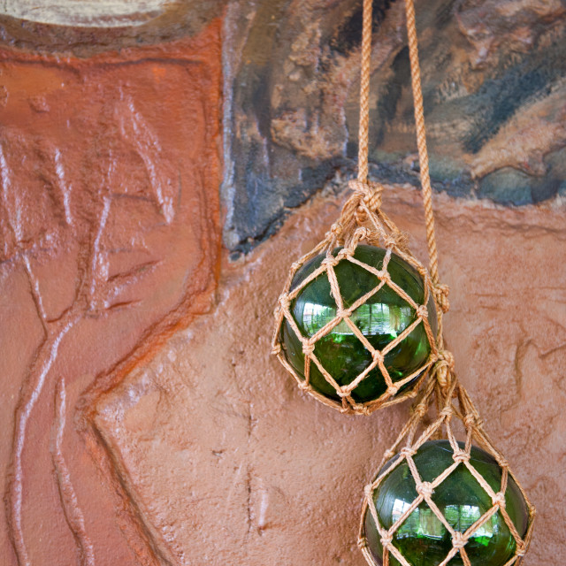 """Two green glass balls dangle"" stock image"