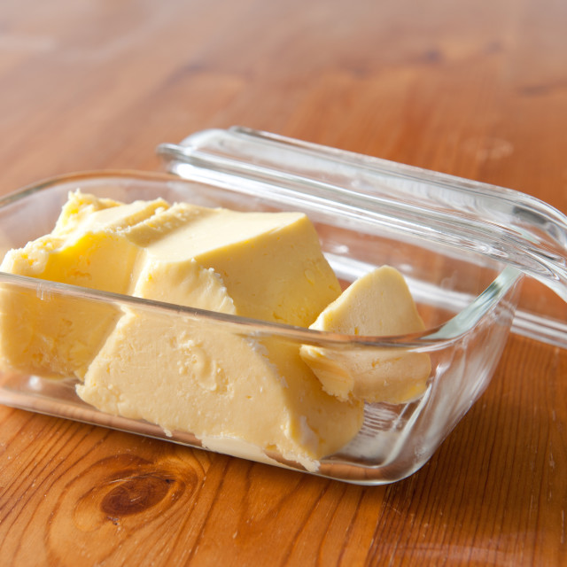 """""""Home made butter in glass butter dish"""" stock image"""