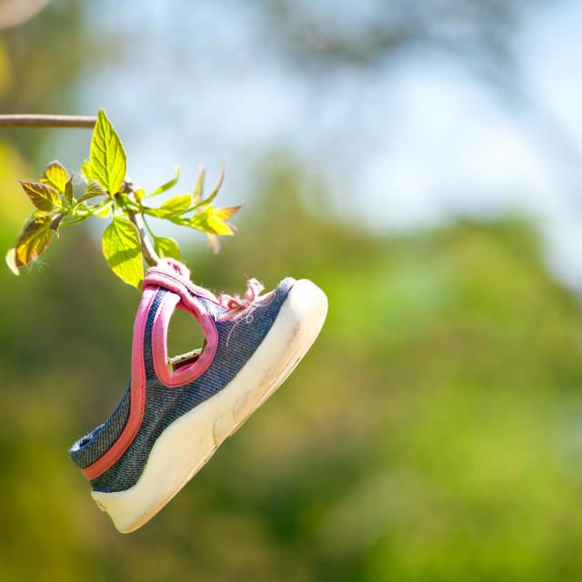 """Single little child shoe hang"" stock image"