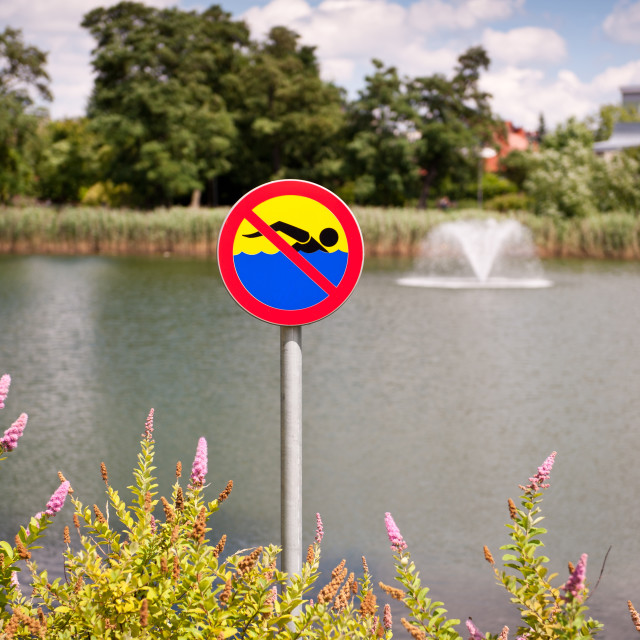 """No swimming warming symbol"" stock image"