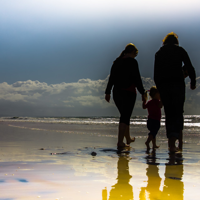 """A walk on the Beach"" stock image"