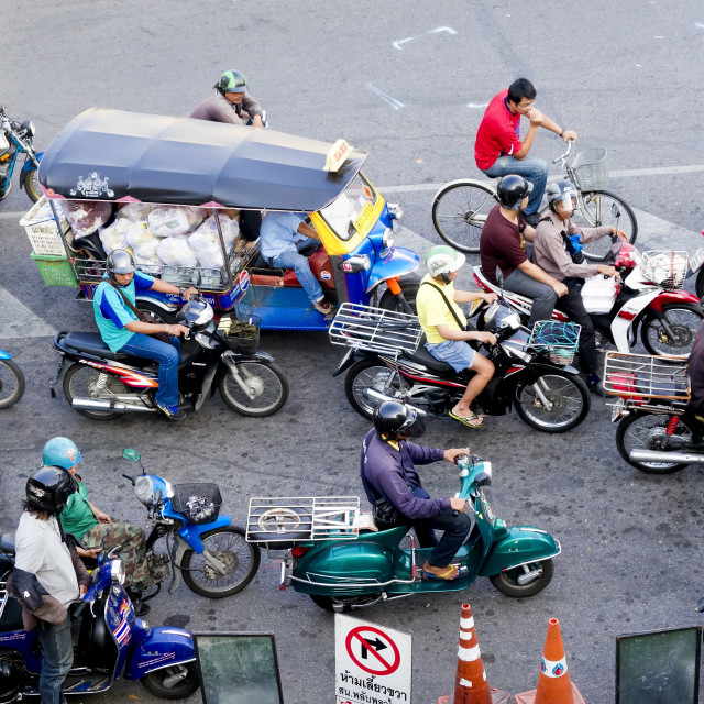 """Traffic, Tuk-tuk and Vespas, bikes, Bangkok"" stock image"