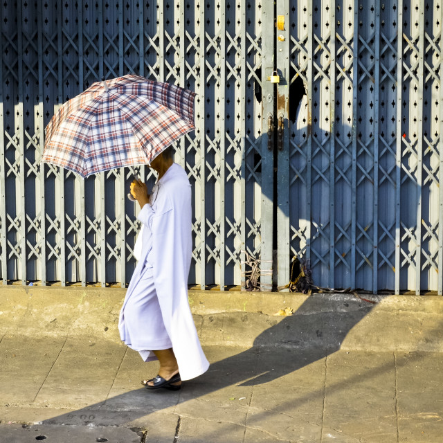 """Buddhist Man with umbrella"" stock image"
