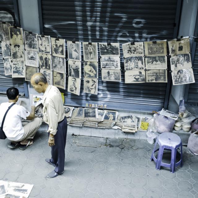 """Asian street vendor selling historical photos"" stock image"