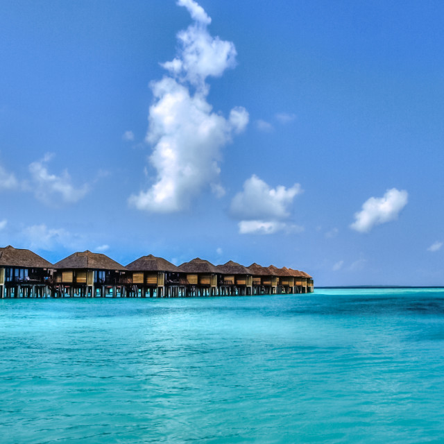 """View of water bungalows in tropical paradise"" stock image"