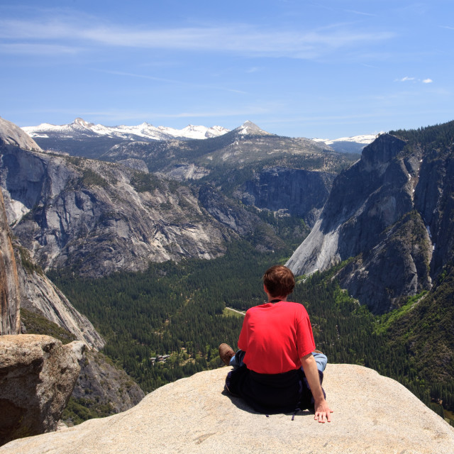 """Hiker overlooking Yosemite view"" stock image"