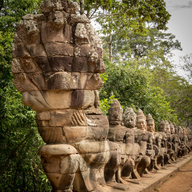 """""""Warriors line entrance to south gate angkor thom"""" stock image"""
