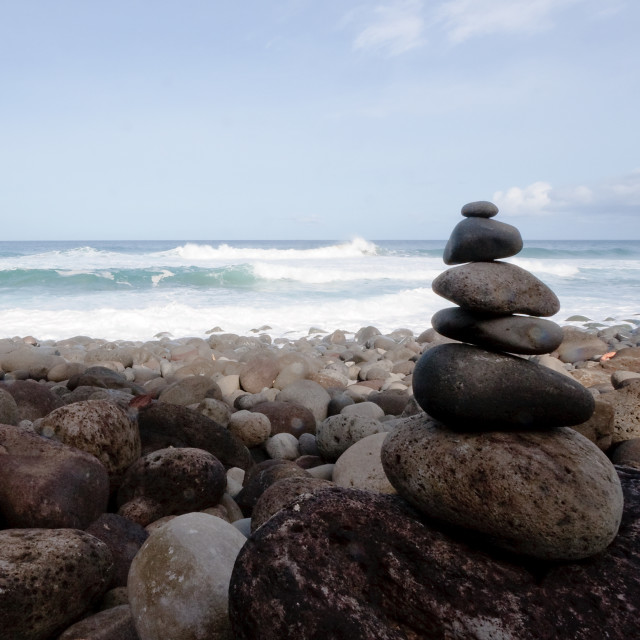 """Rock pile on rocky beach"" stock image"