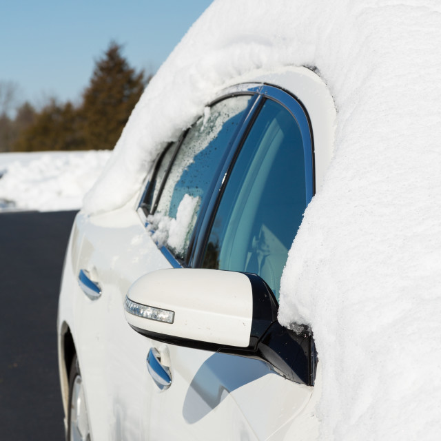 """""""Deep snow on top of white car in drive"""" stock image"""